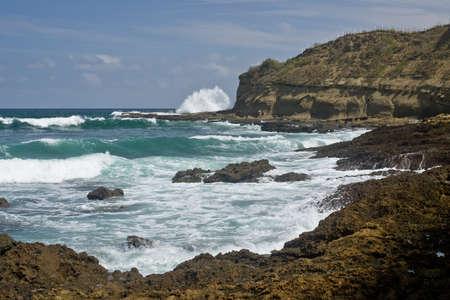 Waves on the  rocky Shore at Montanita Ecuador Фото со стока