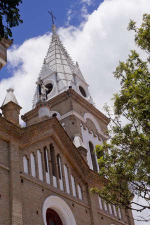 loja: Colonial Church in Ecuador, blue sky and clouds Stock Photo