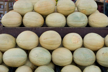 Fresh melons on display for sale at farmers market