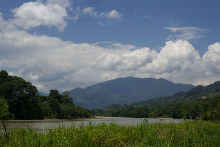 The Zamora river with the Andes mountains as it flows towards the amazon green in front Stock Photo - 17102390