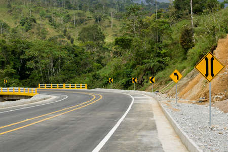 A new modern road in Ecuador, with a bridge and road signs, fresh and clean Stock Photo - 17102391
