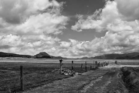 farm road in the high plans  Sierra  of Ecuador, Bluse sky, high clouds and mountains in distant background Black and white Stock Photo - 17191832