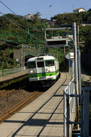 Kasashima, Japan,Oct 23,2010 -Train pulling into rual Japanese station   The extensive and modern japanese rail system serves large and small communities throughout Japan  Editorial