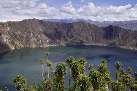 Blue green lake in Quilotoa Volcano, Ecuador taken in early morning Stock Photo