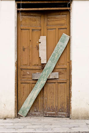 Old wooden Door in Old wall colonial Latin America