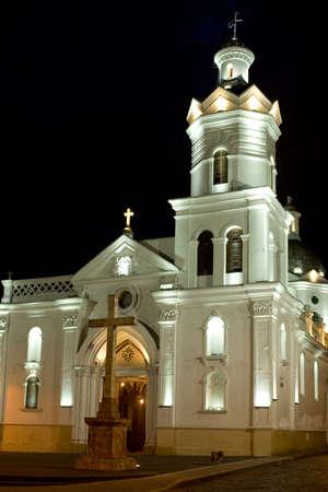 Colonial church at night in latin America Cuenca Ecuador Фото со стока