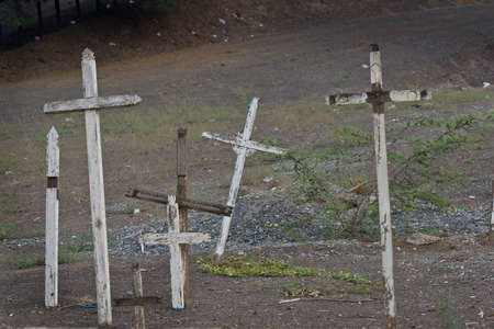 Old wooden crosses in dusty cemetery