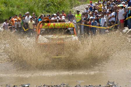 MALACATOES LOJA ECUADOR FEB 10 2013. Custom 4X4 race on riverside Malacatoes Southern Ecuador Feb 10 2013. Town names are painted on the raders.
