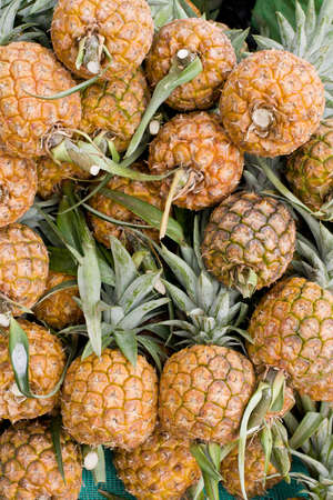 fresh pineapples at Ecuador market piled for sale Stock Photo