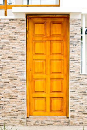 Modern door in new brick wall Stock fotó