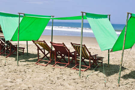 SAN CLEMENTE ECUADOR, FEBRUARY-2013  Beach chairs on sandy sunny beach Feb 2013 in San Clemente Ecuador San Clemente is a fishing village on the Pacific coast of Ecuador