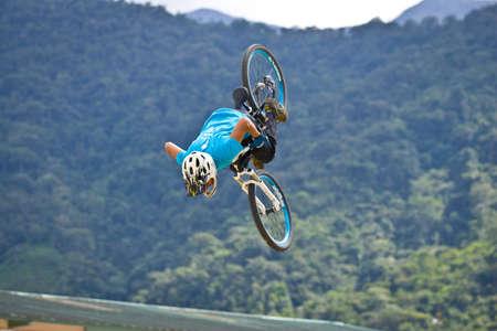 ZAMORA REGION,ZAMORA, ECUADOR, April 27 2013.  Mountain Bike Jumping Tricks in Zamora Ecuador on April 27 2013. Extreme sports demonistrations were part of a tourism conference. Rider Juan Alfonso Reece