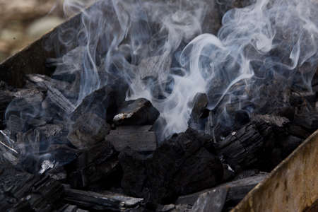Close-up of smoke rising from Charcoal used in cooking grill