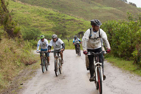 mountainbiking: ZAMORA REGION, ECUADOR-July  13 2013:Riders  in the rain and mud in the Andes Mountains on July 13, 2013. Governments in Ecuador are actively promoting fitness activities.