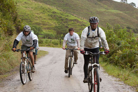 ZAMORA REGION, ECUADOR-July  13 2013:Riders  in the rain and mud in the Andes Mountains on July 13, 2013. Governments in Ecuador are actively promoting fitness activities.