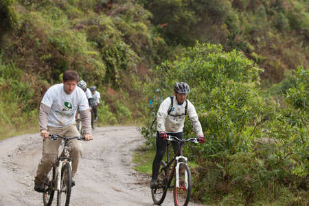 ZAMORA REGION, ECUADOR-July  13 2013:Rider Victor Gravot and Darwin Nunez in the rain and mud in the Andes Mountains on July 13, 2013. Governments in Ecuador are actively promoting fitness activities.