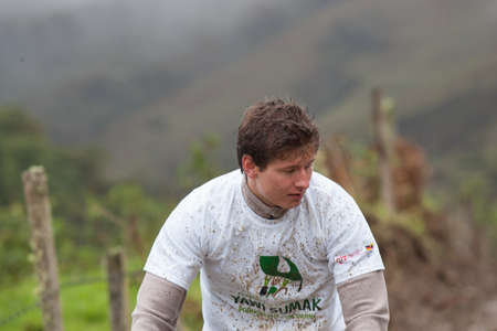 ZAMORA REGION, ECUADOR-July  13 2013:Rider Victor Gravot  in the rain and mud in the Andes Mountains on July 13, 2013. Governments in Ecuador are actively promoting fitness activities.
