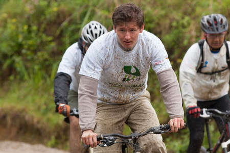 mountainbiking: ZAMORA REGION, ECUADOR-July  13 2013:Rider Victor Gravot  in the rain and mud in the Andes Mountains on July 13, 2013. Governments in Ecuador are actively promoting fitness activities.