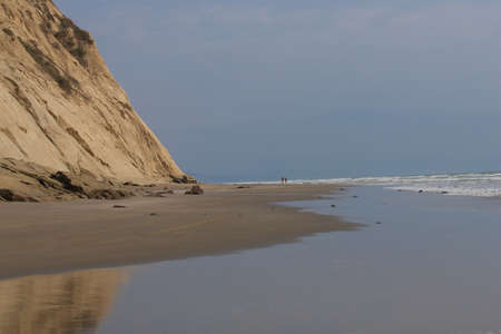 Sandy beach at low tide North of San Clemente Ecuador, clouds, slightly overcast  Stock Photo