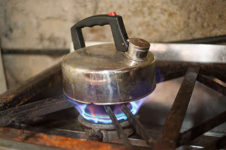 kettle on gas flame cooker large flame