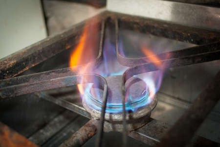 Old gas cook flame blue with orange