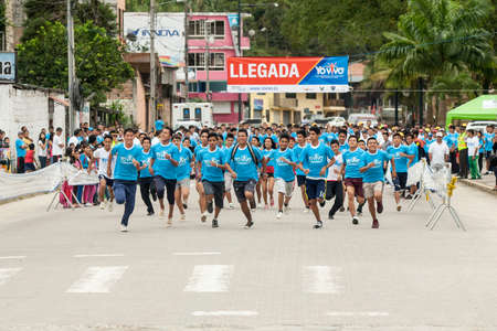 ZAMORA,ZAMORA CHINCHIPE ECUADOR, June 22 2014. Runners in a 5K run in southern Ecuador, Zamora, Zamora Chinchipe Circa June 22 2014. The governements of Ecuador promote fitness with events such as 5K runs Editorial