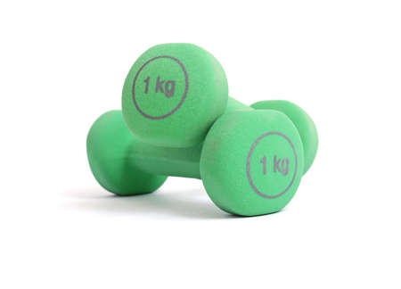 free weight: Two green kilogram dumbbells