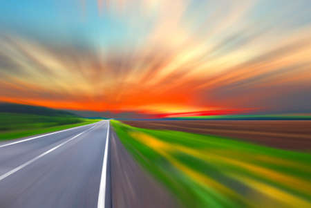road ahead: Blurred road and blurred sky with sunset