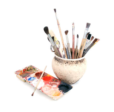 palete and pot with brushes Banco de Imagens
