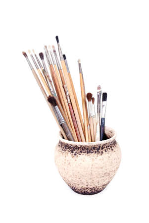 pot with brushes photo