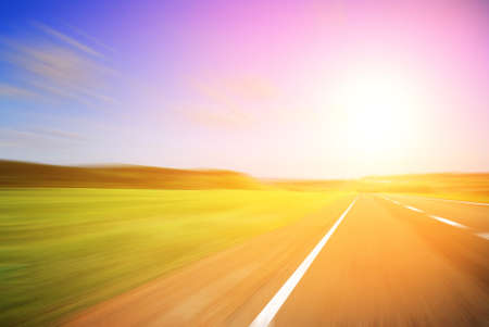 sulight: Blurred road and blurred sky with a shining sun