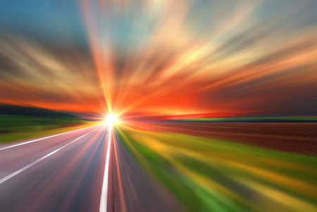 sulight: Blurred road and blurred sky with sunset