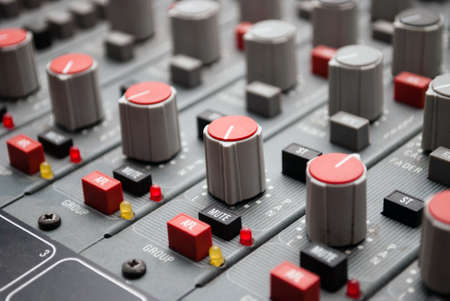 sound mixer console with highlighted button, pump the volume