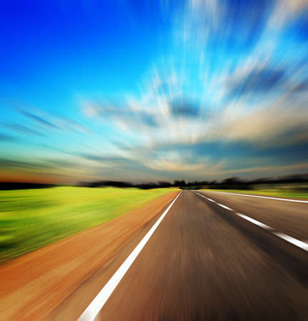 blured road and blue sky Stock Photo