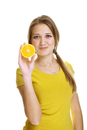 finger licking: young woman with orange slice studio shot Stock Photo