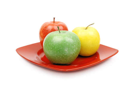 A close up of a  red plate with juicy green yellow and red apple