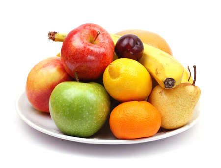 fruit plate with citrus fruits, apples, banana, plum photo