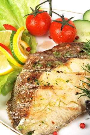 Grilled Foods - Grilled Fish with Lemon and Cherry Tomato Stock Photo - 12252305