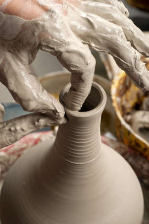 make dirty: hands of a potter, creating an earthen jar on the circle