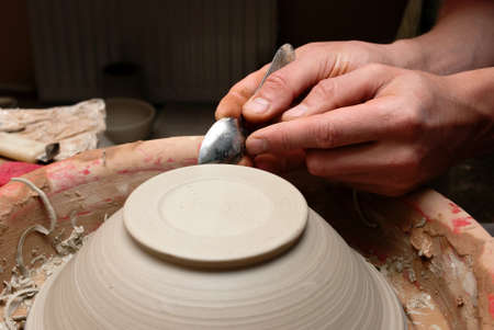 hands of a potter, creating an earthen jar on the circle Stock Photo - 12667843
