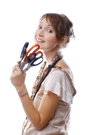 young smiling girl holds in her hand scissors