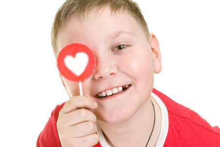 kid with heart shaped lollipop photo