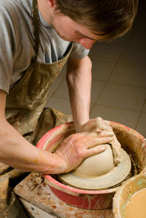 Potter working at his workshop photo