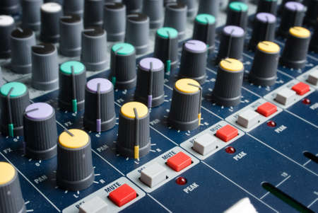 sound mixer console with highlighted button, pump the volume photo
