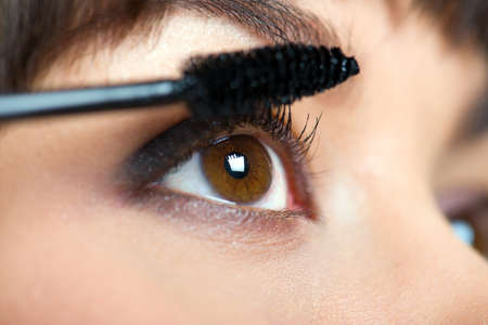 Makeup. Make-up. Applying Mascara. Long Eyelashes photo