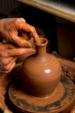 hands of a potter, creating an earthen jar Standard-Bild