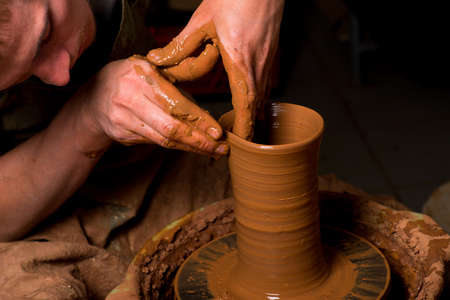 potter: hands of a potter, creating an earthen jar Stock Photo