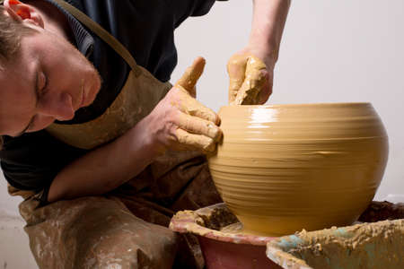 craftswoman: hands of a potter, creating an earthen jar Stock Photo