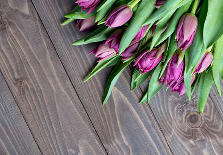tulips bouquet on wooden background. photo