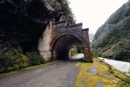 drive through: Road Tunnel - Mountain Tunnel in Abkhazia Stock Photo